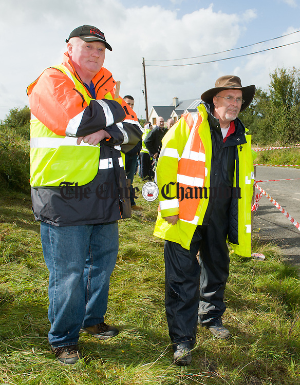 Marshalls Brendan O Connell and Martin Bond making sure all is safe during Stage 5 of the Clare Stages Rally at Ballinruan/Crusheen. Photograph by John Kelly.
