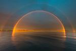 Double rainbow over calm seas, Svalbard, Norway