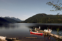 Family enjoying Canoeing (Red Canoe), Boating, and Fishing at Makeshift Dock in Dodd Lake, near Powell River, British Columbia, Canada