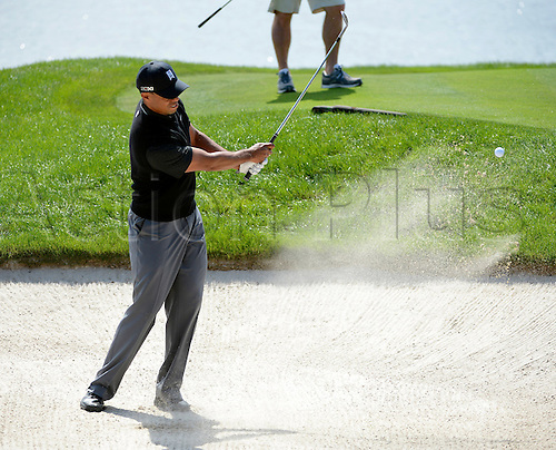 02.03.2013 Florida, USA. Tiger Woods hits his ball out of a bunker on the 18th hole during the third round of the Honda Classic at the PGA National Resort & Spa in Palm Beach Gardens, FL.