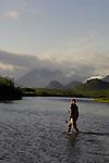 An angler crossing the Kulik River, Alaska