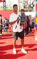 WWW.BLUESTAR-IMAGES.COM  Los Angeles Laker Nick Young and son Nick Young Jr. arrive at the Los Angeles premiere of 'The Lego Movie' held at Regency Village Theatre on February 1, 2014 in Westwood, California.<br /> Photo: BlueStar Images/OIC jbm1005  +44 (0)208 445 8588