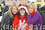 Patricia O'Sullivan, Brid Coffey and Eilish Coffey Killarney at the start of  the annual childrens motorbike toy run at Doyle's shop  Killarney on Sunday ..
