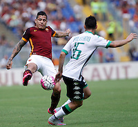 Calcio, Serie A: Roma vs Sassuolo. Roma, stadio Olimpico, 20 settembre 2015.<br /> Roma&rsquo;s Juan Iturbe, left, is challenged by Sassuolo&rsquo;s Matteo Politano during the Italian Serie A football match between Roma and Sassuolo at Rome's Olympic stadium, 20 September 2015.<br /> UPDATE IMAGES PRESS/Isabella Bonotto