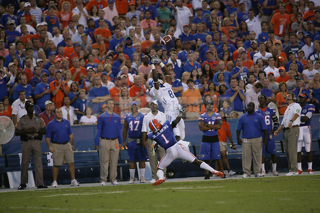 "Receiver Chris Matthews reaches for a pass from Mike Hartline during the first half of UK's game against Florida at the ""Swamp"" in Gainesville, Florida on Saturday, Sept. 25, 2010. Photo by Brandon Goodwin 