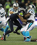 Seattle Seahawks outside linebacker Mike Morgan (57) wraps up Carolina Panthers running back Jonathan Stewart (28) at CenturyLink Field in Seattle, Washington on December 4, 2016.  Seahawks beat the Panthers 40-7.  ©2016. Jim Bryant photo. All Rights Reserved.