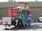 Zack Elbay eats outside the Yummy Dog food truck on Durham Thursday Oct 09, 2014.(Dave Rossman photo)