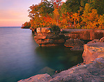 Big Bay State Park, WI<br /> Lake Superior and sandstone cliffs of Big Bay Point at dawn.  Madeline Island, Apsotle Islands, Ashland County