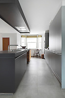 A 'Burnaby St' kitchen by Bulthaup, with simple grey units that bear a minimalist gravity
