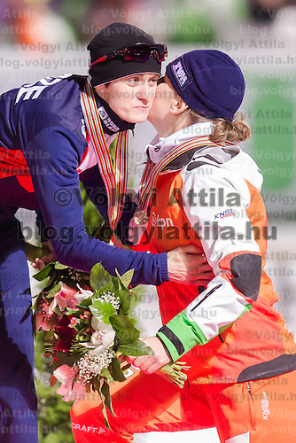 Czech Republic's Martina Sablikova (L) and Netherlands' Ireen Wuest (R) celebrate their victory on the Speed Skating All-round European Championships in Budapest, Hungary on January 8, 2012. ATTILA VOLGYI