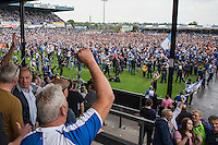 Fans celebrate during a pitch invasion after the Sky Bet League 2 match between Bristol Rovers and Dagenham and Redbridge at the Memorial Stadium, Bristol, England on 7 May 2016. Photo by Mark  Hawkins / PRiME Media Images.