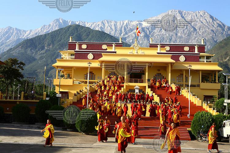 Monks exit the Gyuto Tantric Monastic University.