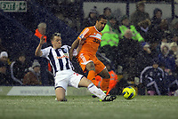 Pictured: Wayne Routledge (R) tackled by Nicky Shorey of West Bromwich. Saturday, 04 February 2012<br />