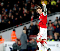 Mesut Ozil of Arsenal acknowledges the fans after his pass which lead to the third goal during the Premier League match between Arsenal and Huddersfield Town at the Emirates Stadium, London, England on 29 November 2017. Photo by Carlton Myrie / PRiME Media Images.