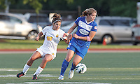 Boston Breakers forward Katie Schoepfer (12) controls the ball as Western New York Flash midfielder Angela Salem (6) pressures. In a National Women's Soccer League Elite (NWSL) match, the Boston Breakers (blue) tied Western New York Flash (white), 2-2, at Dilboy Stadium on June 5, 2013.