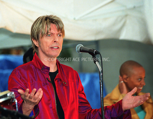 "David Bowie looks a bit concerned as he experiences problems with sound as he performs on NBC's ""Today Show"" as part of Summer Concert Series. New York, June 14, 2002. Please byline: Alecsey Boldeskul/NY Photo Press.   ..*PAY-PER-USE*      ....NY Photo Press:  ..phone (646) 267-6913;   ..e-mail: info@nyphotopress.com"