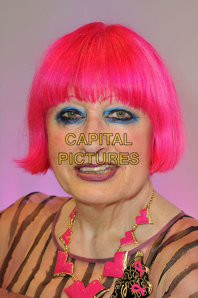 Afternoon Tea with Zandra Rhodes.  British fashion designer hosts afternoon tea event and Q&A for press to launch her new handbag collection at Pure London, London Olympia, London, England..August 20th, 2012.headshot portrait pink hair dyed necklace blue eyeliner make-up beauty sheer stripe.CAP/BF.©Bob Fidgeon/Capital Pictures.