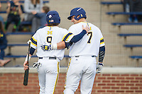 Michigan Wolverines shortstop Michael Brdar (9) and Harrison Wenson (7) walk to the dugout during the game against the Eastern Michigan Hurons on May 3, 2016 at Ray Fisher Stadium in Ann Arbor, Michigan. Michigan defeated Eastern Michigan 12-4. (Andrew Woolley/Four Seam Images)