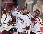 Pat Mullane (BC - 11), Michael Matheson (BC - 5), Steven Whitney (BC - 21) - The Boston College Eagles defeated the visiting University of New Hampshire Wildcats 5-2 on Friday, January 11, 2013, at Kelley Rink in Conte Forum in Chestnut Hill, Massachusetts.