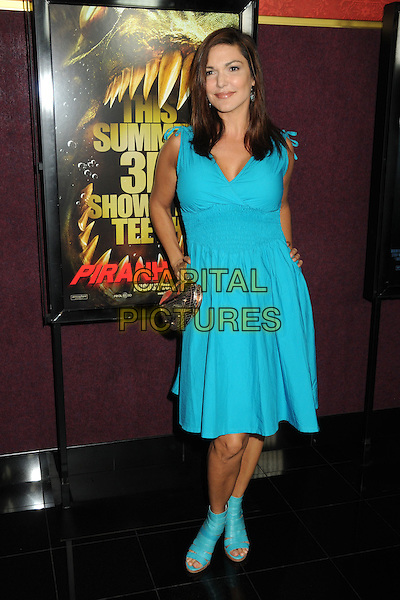 "LAURA HARRING .""Piranha 3D"" Los Angeles Premiere held at Mann's Chinese 6 Theatre, Hollywood, California, USA, .18th August 2010 .full length turquoise blue dress hands on hips sandals bag .CAP/ADM/BP.©Byron Purvis/AdMedia/Capital Pictures."