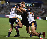 Sharks player Rob du Preez (C) is tackled by Brumbies players Folau Fainga'a (L) and Wharenui Hawera (R) during the Super Rugby match between the ACT Brumbies and the South African Sharks in Canberra on March 17, 2018. AFP PHOTO / MARK GRAHAM --- IMAGE RESTRICTED TO EDITORIAL USE - STRICTLY NO COMMERCIAL USE --