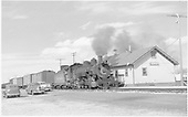 D&amp;RGW #494 with mixed-gauge freight train passing Romeo depot.  Three vintage 1940s automobiles.<br /> D&amp;RGW  Romeo, CO  3/31/1950