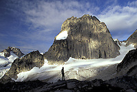 Climber silhouetted below Snowpatch Spire, Bugaboo Glacier Provincial Park, British Columbia, Canada