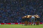 Wolves players performing a team huddle at St. Andrew's stadium, just prior to Birmingham City's Barclay's Premier League match with Wolverhampton Wanderers. Both clubs were battling against relegation from  England's top division. The match ended in a 1-1 draw, watched by a crowd of 26,027.