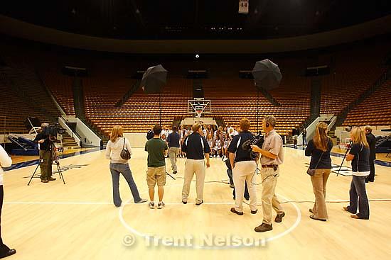 Provo - BYU photographer Jaren Wilkey organizes team photo of the womens basketball team, at BYU basketball's media day, Thursday at the Marriott Center.