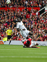 Pictured: Bafetimbi Gomis of Swansea (TOP) against Tyler Blackett of Manchester United. Saturday 16 August 2014<br />