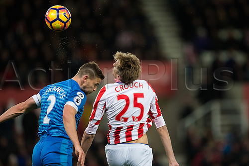19.11.2016. Bet365 Stadium, Stoke, England. Premier League Football. Stoke City versus AFC Bournemouth. Stoke City forward Peter Crouch and Bournemouth defender Simon Francis.