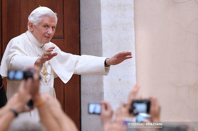 Pope Benedict XVI faces pilgrims gathered in the courtyard of his summer residence of Castelgandolfo, 40 km southeast of Rome, upon his arrival for a weekly general audience on August 17, 2011.