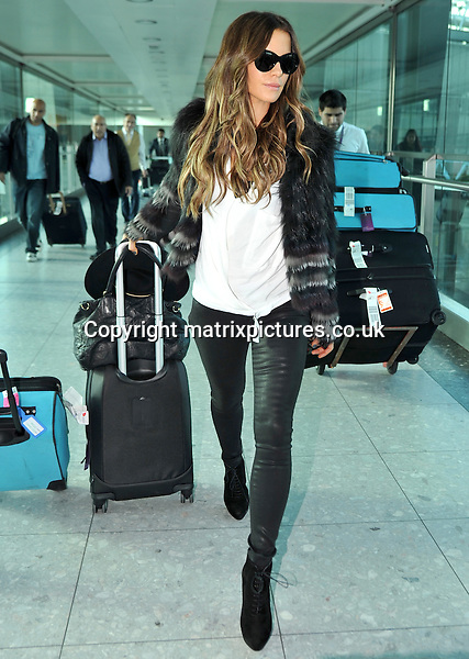 NON EXCLUSIVE PICTURE: MATRIXPICTURES.CO.UK<br /> PLEASE CREDIT ALL USES<br /> <br /> WORLD RIGHTS<br /> <br /> English actress Kate Beckinsale is pictured as she arrives at London Heathrow Airport, after a flight from Los Angeles.<br /> <br /> The 40 year old looks glamorous in a pair of skin tight leather trousers. <br /> <br /> NOVEMBER 4th 2013<br /> <br /> REF: STD 137148