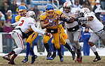 BROOKINGS, SD - NOVEMBER 22:  Zach Zenner #31 from South Dakota State University tries to shake Micheal Lilly #2 John Wessel #28 and Auston Johnson #1 from the University of South Dakota in the first half of their game Saturday at Coughlin Alumni Stadium in Brookings. (Photo by Dave Eggen/Inertia)