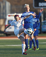 Washington Spirit midfielder Diana Matheson (8) attempts to control the ball as Boston Breakers midfielder Joanna Lohman (11) defends. In a National Women's Soccer League Elite (NWSL) match, the Boston Breakers (blue) tied the Washington Spirit (white), 1-1, at Dilboy Stadium on April 14, 2012.