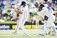 23rd November 2019; Mt Maunganui, New Zealand;  Mitchell Santner batting on Day 3, 1st Test match between New Zealand versus England. International Cricket at Bay Oval, Mt Maunganui, New Zealand.  - Editorial Use