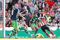 Sadio Mane scores a goal to make it 3-0 during the Barclays Premier League match between Southampton v Swansea City played at St Mary's Stadium, Southampton