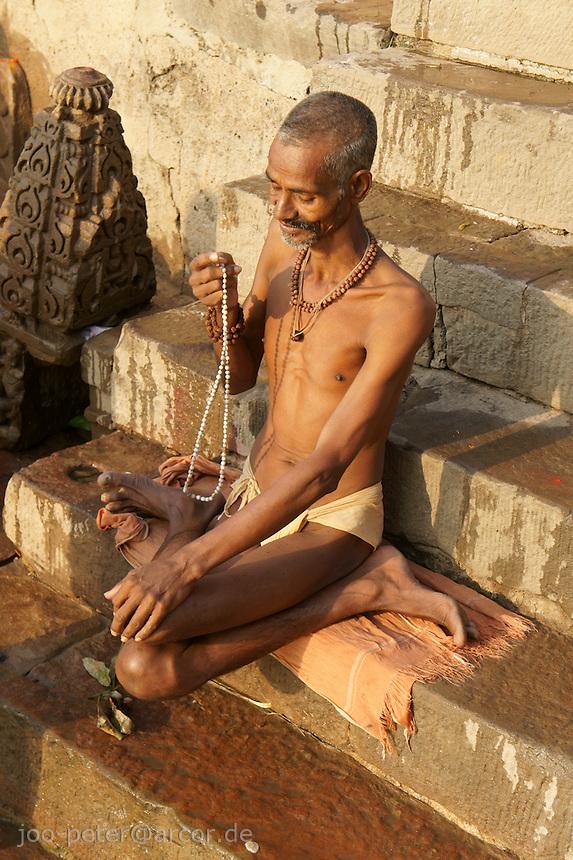 Man praying at river Ganga after taking bath in the holy water