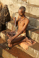 Man praying at river Ganga after taking bath in the holy water