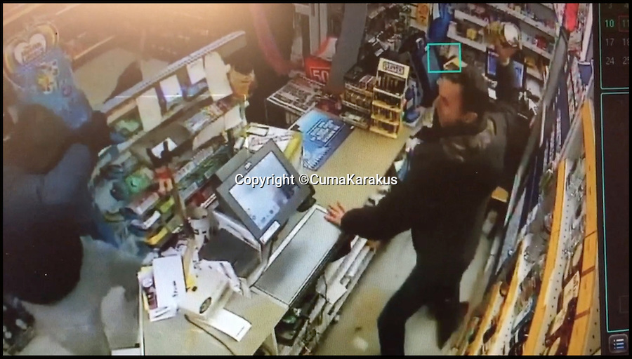 BNPS.co.uk (01202 558833)<br /> Pic: CumaKarakus/BNPS<br /> <br /> The moment that Cuma picked up a jar of dog treats.<br /> <br /> This is the dramatic movement a heroic shopkeeper scared off a knife-wielding raider by launching a glass jar of dog biscuits at him. <br /> <br /> Brave Cuma Karakus dodged the masked thug's eight inch blade as he jabbed over the counter armed only with the treats he keeps for customers' pets. <br /> <br /> The dad of two then incredibly threw it at the crook as he tried to run around the table, appearing to hit a glancing blow on his hand.