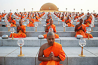 Buddhist monks pray during alms offering ceremony at the Wat Phra Dhammakaya temple in Pathum Thani province, north of Bangkok on Makha Bucha Day March 4, 2015. The Dhammakaya temple members include some of Thailand's most powerful politicians and is regarded as the country's richest Buddhist temple. Makha Bucha Day honours Buddha and his teachings, and falls on the full moon day of the third lunar month.  REUTERS/Damir Sagolj (THAILAND)
