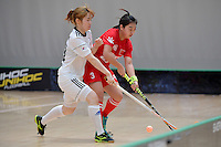 Korea's Ran Kim and China's Yibo Zhao in action during the World Floorball Championships 2017 Qualification for Asia Oceania Region - Korea v China at ASB Sports Centre , Wellington, New Zealand on Saturday 4 February 2017.<br /> Photo by Masanori Udagawa<br /> www.photowellington.photoshelter.com.