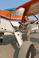 Danielle Tirrell refuels a De-Havilland Beaver airplane at the airport in Coldfoot, Alaska.