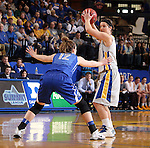 BROOKINGS, SD - MARCH 23:  Steph Paluch #15 from South Dakota State looks for a teammate while under pressure from Lauren Works #12 from Creighton in the first half of their WNIT game Sunday afternoon at Frost Arena in Brookings. (Photo by Dave Eggen/Inertia)