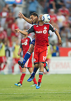 FC Dallas defender/midfielder Daniel Hernandez #2 and Toronto FC defender Mikael Yourassowsky #19 in action during an MLS game between the FC Dallas and the Toronto FC at BMO Field in Toronto on July 20, 2011.
