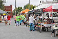 NWA Democrat-Gazette/MICHAEL WOODS &bull; @NWAMICHAELW<br /> People shop at the Rogers Farmers Market  Wednesday September 30, 2015.  Main Street Rogers announced it will take over ownership of the Rogers Farmers Market starting next year.  Several current  vendors at the Rogers Farmers Market expressed their concerns after the announcement and are considering moving their market to a new location after the takeover.