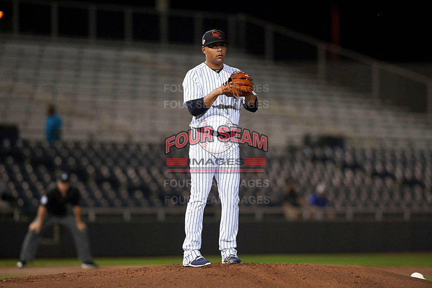 Scottsdale Scorpions starting pitcher Justus Sheffield (34), of the New York Yankees organization, prepares to deliver a pitch to the plate during an Arizona Fall League game against the Mesa Solar Sox on October 23, 2017 at Scottsdale Stadium in Scottsdale, Arizona. The Solar Sox defeated the Scorpions 5-2. (Zachary Lucy/Four Seam Images)