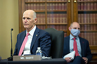 United States Senator Rick Scott (Republican of Florida) listens during a United States Senate Committee on the Budget business meeting at the United States Capitol in Washington D.C., U.S., on Thursday, June 11, 2020, as they consider the nomination of Director, Office of Management and Budget (OMB) Russell Vought to be White House Office of Management and Budget.  Credit: Stefani Reynolds / CNP/AdMedia