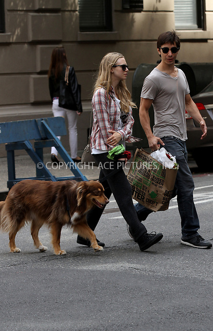 WWW.ACEPIXS.COM<br /> <br /> <br /> September 9, 2013, New York City, NY.<br /> <br /> <br /> Amanda Seyfried and Justin Long out for a walk with her dog on September 9, 2013 in New York City, NY<br /> <br /> <br /> <br /> By Line: Zelig Shaul/ACE Pictures<br /> <br /> ACE Pictures, Inc<br /> Tel: 646 769 0430<br /> Email: info@acepixs.com