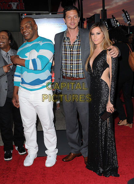Mike Tyson, Simon Rex and Ashley Tisdale .at The Dimension Films Premiere of 'Scary Movie 5' held at The Cinerama Dome in Hollywood, California, USA, April 11th 2013.                                                               .full length dress sleeves cut out sheer see thru through black sequined sequin low cut ombre hair dyed clutch grey gray suit plaid checked shirt blue white print jumper sweater trousers .CAP/DVS.©Debbie VanStory/Capital Pictures